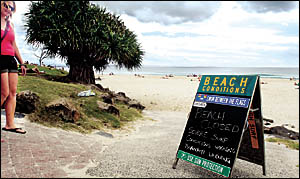 Some beachgoers ignored Tsunami warning signs at Main Beach, Byron Bay yesterday in front of the surf club.
