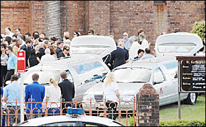 THE scene outside Saint Carthage?s following the funeral services for the two priests.