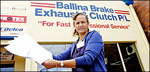 Colleen Trease, from Ballina Brake, Exhaust and Clutch, holds the scam letter circulating Northern Rivers businesses. The lette
