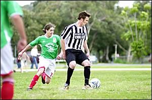 Byron Bay?s Shaun Packham, right, in action against Italo Stars last season.