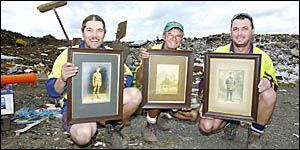 : Northern Rivers Waste workers (from left) Sean Elliott, Mick Byrne, and Charlie Crethar with the WWI photographs they found t