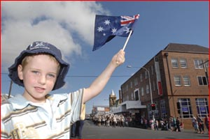 Children like Harrison Langdon wave the Australian flag as they pay homage to Toowoomba's Diggers