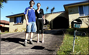 PROPERTY LADDER: Gary and Rebecca Watson from Lismore in front of one of their investment properties in Goonellabah