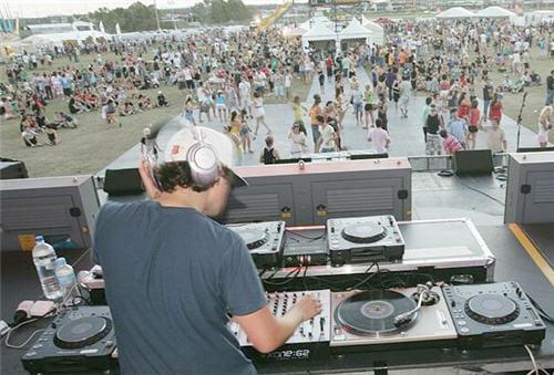 Malibu Sunset Social dance party - US DJ Andy Caldwell entertains the crowd at Kawana's Quad Park.