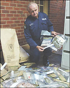 DRUGS HAUL: Sgt Cliff McPherson at the Lismore police station on Sunday with some of the drugs seized by police during the Mard