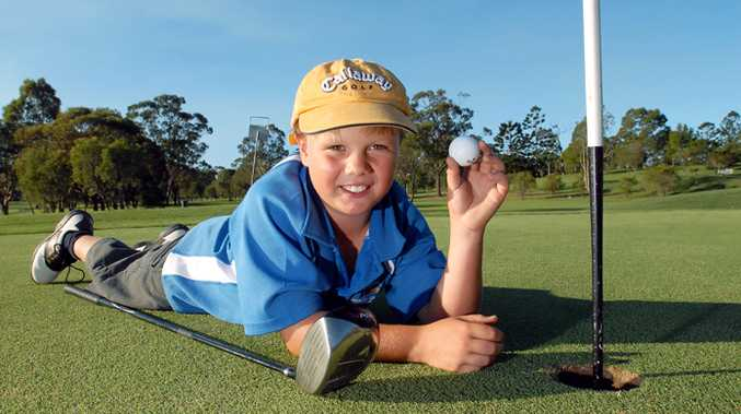 Young golfing sensation Jack Pountney holds up his ace ball yesterday.