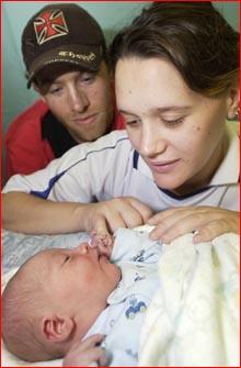 Melissa Jones, and her partner Jacob Reid, ogle over the wonder of their new baby, Jackson Victor Reid, yesterday.
