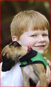 Six-year-old diabetic Demarco Merrett with his new puppy, Chino.
