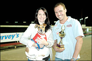 Jack Russell winner Dixie with owners Jessica and Darren Donadel and the Terry Hassett Jack Russell Cup.
