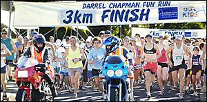 RUN IN THE SUN: Competitors get started on the 6km Southern Cross University Darrel Chapman Fun Run. Women??s winner (front, sec