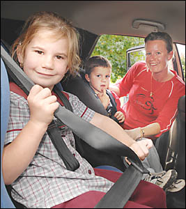 BUCKLING UP FOR SAFETY: Nadine Toniello, of Lismore, buckles her children Jakira, six, and Brady, three, in their safety booste