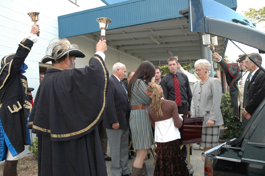 Mourning ... Town criers from all over Australia form a guard of honour at yesterday's farewell to John Kerr.