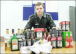 FROM THE MOUTHS OF BABES: Constable Daniel Wills pictured with alcohol confiscated on Friday and Saturday at Byron Bay and Suff