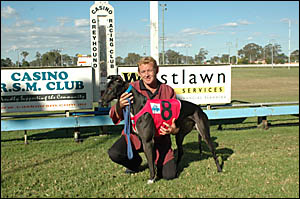 THEY?LL DRINK TO THAT: Trainer Terry Darragh and Top Pub Pup ? a winner at Casino last Friday ? named and owned by drinkers at