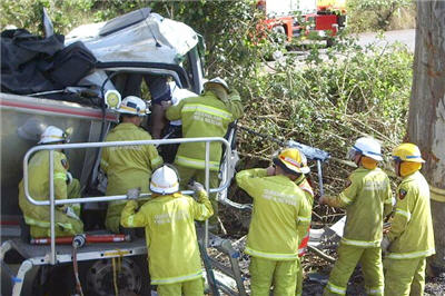 Firefighters at the scene of the truck smash at Imbil where a 35-year-old man died.