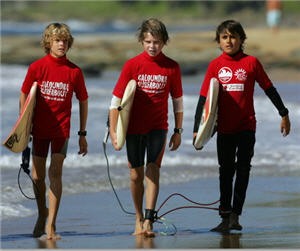 SWELL TIME: Ryan Forman, Roly Burgess and Nicholas Davies prepare to hit the surf. See end of story for link to more pictures.