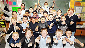 Coraki Public School year 5 and 6 boys and their teachers Audrey Zambelli (far left middle row), Keith Martin (back left) and M