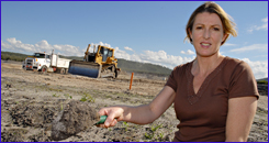 SOILED: The Sunshine Coast Environment Council's Narelle McCarthy scoops up fill taken from former farmland.