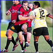 CHEEKY MOVE: Nambour try scorer, Dylan Fahey, is put into a gap by a grinning Bruce Heard.
