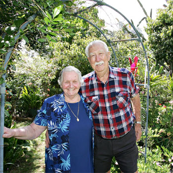 Jean and Ralph Sawrey in their garden at Nambour.