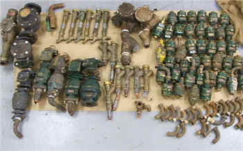 Some of the water meters and plumbing components recovered by police.