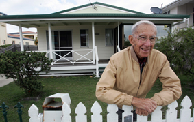 Marshal Huxley outside his home which is tipped to fetch up to a million dollars at auction today.