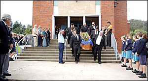 FINAL! JOURNEY: Pallbearers carry the casket from Our Lady of Sorrows Catholic Church in Kyogle yesterday. They are (front left