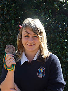 GOLDEN GIRL: Jorja Wilson proudly displays the medal she won at the National Judo Championships in Adelaide recently. Picture: