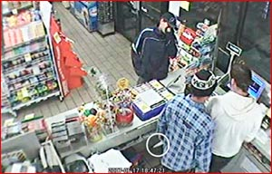 The male attendant at the West Street Mobil Service Station was besieged by two men, one brandishing a knife (circled).