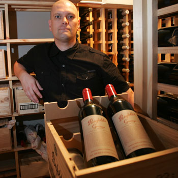 Master sommelier Michael Brooks in the cellar of Noosa's Sails restaurant with the latest delivery of Penfolds Grange