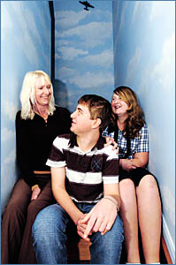 CLOSE CALL: 15-year-old Trevor Herne, pictured at home with his mother Aileen, and sister Samantha. Six weeks after falling ill