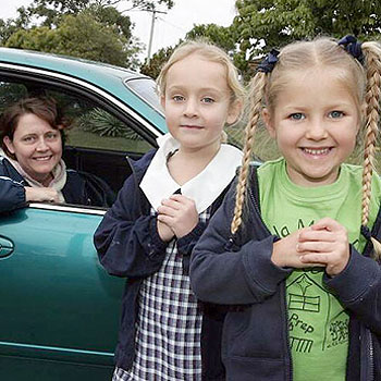 Looking for some divine intervention for care on the road are Allison Brown of Buderim and Gabby,6, and friend Elly Scanlan.