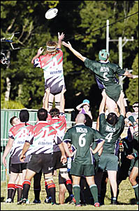 HIGH AND MIGHTY: Chris Woodley (Coolangatta-Tweed) and Glen Paisley (Lismore) contest possession in a line-out in the game at L