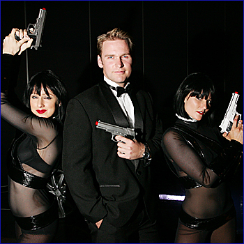 Dressed to thrill are Anita Mammarella, Chris McKillop and Amanda Taylor at the Reed Charity Foundation James Bond Gala Ball. About 600 people turned out at the University of the Sunshine Coast.