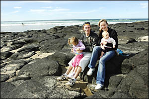 ATTACK FLASHBACKS: Shark victim Matt McIntosh visits Shelly Beach with his wife Leonie, and daughters Jessie, 3, and Summer, 6
