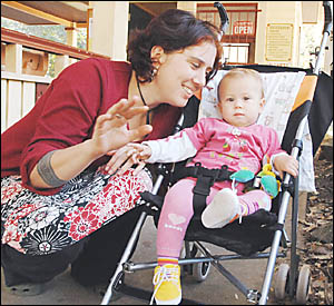 AGAINST MOVE: Pictured with her 11-month-old daughter, Scarlett Duncan, Nimbins Maire Barron believes the new stroller laws ar