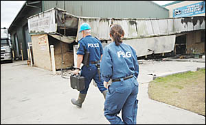 SIFTING FOR EVIDENCE: Forensic police attend the scene of a fire at Ballinas Southern Cross Industrial Estate. Picture: DOUG E