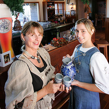 Barbara Lutze and her daughter Enya serve up some hot malt beer as part of Maleny restaurant King Ludwig's Christmas in Winter celebrations. Photo: Brett Wortman