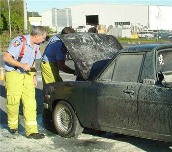 This Datsun ute caught fire on the Sunshine Motorway this afternoon. Photo: Alan Lander