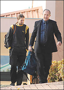 CONFLICTING STORIES: Jens Martin (left) arrives with Homicide Detective Inspector Wayne Hayes at the Lismore Court House yester