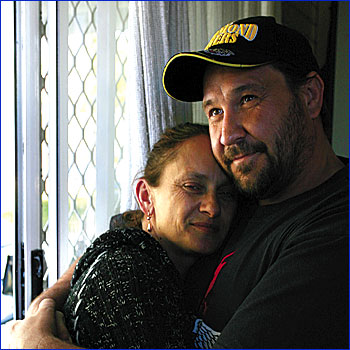 Jason Lane pictured in the loving arms of his partner Greer James. After his Nigerian hostage nightmare, Jason is now battling malaria in Nambour Hospital.