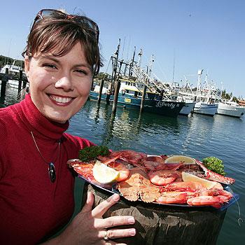 Mooloolaba Seafood Festival president Trudy Atkinson gets up close with one of the Coast's favourite treats. Photo: Barry Leddicoat