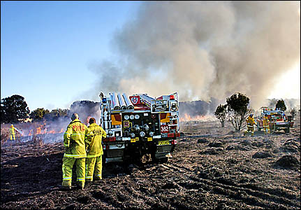 FIRING LINE: NSW Fire Brigade firefighters battle blazes at Coraki for the fourth day in a row with the assistance of the Rural