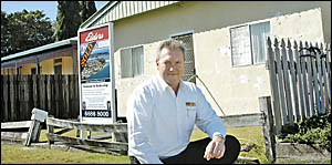 KEEN BIDDING: Elders Real Estate director Glenn Mills outside the Ross Street cottage, Ballina, which sold for $325,000 at auct