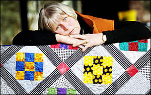 COMFORT BLANKET: Ann Withers, from Clunes, with a quilt friends made for her when she was diagnosed with bowel cancer earlier i