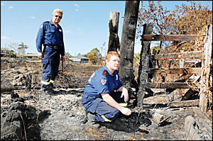 BURNT OUT: Coraki Fire brigade captain Bob Duncan and Beth McGrath in one of the areas ravaged by grass fires in the past week.