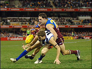 LENNOX LION: The Brisbane Lions Wayde Mills, right, clashes with the Kangaroos Jess Smith in the AFL match at the Gabba last