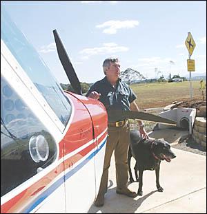 John Gosper, of Booyong, with his Technam light aircraft beside the landing strip he built on his property.