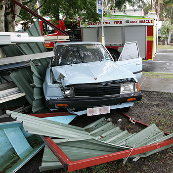 A car smashed through a fence into the yard of a Mudjimba house after careering out of control. Photo: Chris McCormack