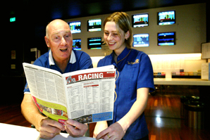KEEN Punter Richard Bliesner with Twin Towns gaming staff member Kalinda White, cast an astute eye over the new form guide.